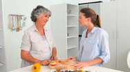 Woman cooking with her mother Stock Footage