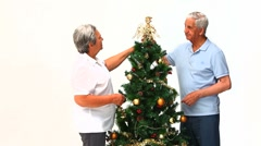Couple decorating the Christmas tree - stock footage