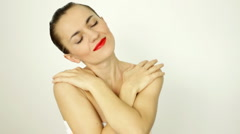 Attractive elegant sexy woman posing and touching her arms, isolated Stock Footage