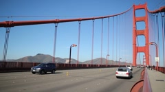 Traffic on the Golden Gate Bridge Shallow Focus on bridge - stock footage