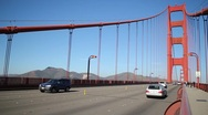 Stock Video Footage of Traffic on the Golden Gate Bridge Shallow Focus on bridge