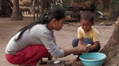 Cambodia: Teaching Boy How to Wash Hands Stock Footage