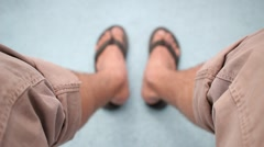 Wearing rolled up pants and looking down at sandals Stock Footage