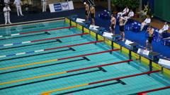 Sportsmen prepare for start of swim - stock footage
