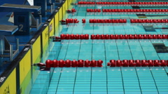 Swimming pool and starting blocks, panorama from top down Stock Footage