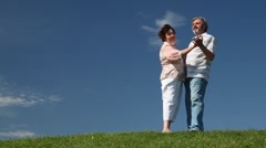 Mature couple cute dance on grass Stock Footage