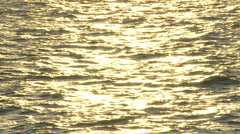 sunset golden ocean slow-motion small waves - stock footage