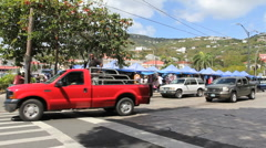 Charlotte Amalie traffic by a market Stock Footage