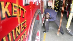 Firefighter Servicing Fire Truck - stock footage