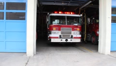 Fire Truck Leaving Fire Station Stock Footage