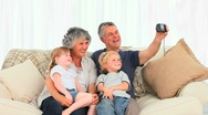 Family taking a picture about themselves Stock Footage