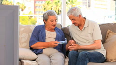 Couple with their pills box Stock Footage