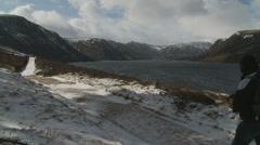 Loch Muick & walker Stock Footage