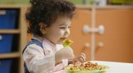 Children eating lunch in kindergarten Stock Footage
