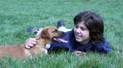 Boy Laying In The Grass With His Dog Stock Footage