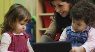 Stock Video Footage of Teacher using tablet pc with children at school