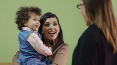 Educator and mother with little girl at school Stock Footage