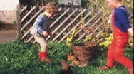 Stock Video Footage of Children play with bunny pups (vintage 8 mm amateur film)