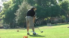 Golfer tees off - stock footage