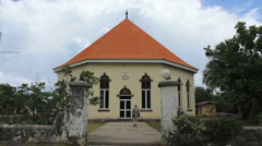 Moorea round church with man walking Stock Footage