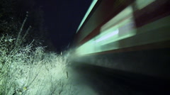 Passenger train on a snowy night Stock Footage