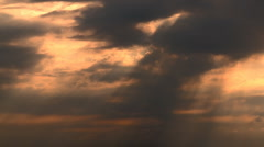 Timelapse of sun shining thru clouds Stock Footage