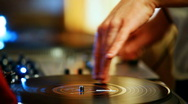 Stock Video Footage of DJ Spinning Records