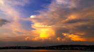 Stock Video Footage of Cumulus clouds over a harbor on evening sun