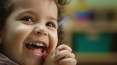 Child laughing and clapping hands - stock footage