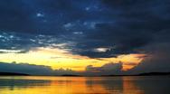 Cumulus clouds over a harbor on evening sun Stock Footage