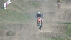 Stock Video Footage of Motocross riders flying