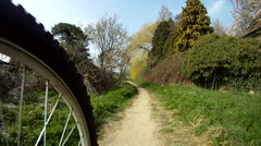 P.o.v bicycle ride on cycle path Stock Footage