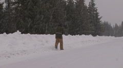 Snow Road Walker #2 of 3 Stock Footage