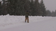 Stock Video Footage of Snow Road Walker #2 of 3