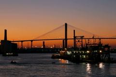 Talmadge Bridge across Savannah River at sunset Stock Footage