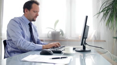 Young businessman having headache in the office Stock Footage