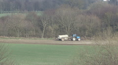 Tractor tows slurry tank at edge of field. Stock Footage