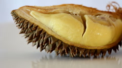 Durian moving across table with reflection Stock Footage