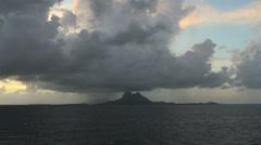 Bora Bora rain at dawn in the distance Stock Footage