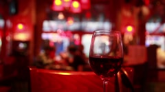 Glass of red wine stands on table Stock Footage