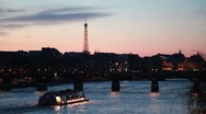 Stock Video Footage of Ship moves on river to iron bridge of night in Paris