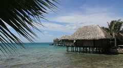 Bora Bora thatched cottage over water  Stock Footage