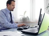 Businessman working on computer and laptop Stock Footage