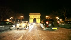 Cars move near The Arc de Triomphe Stock Footage