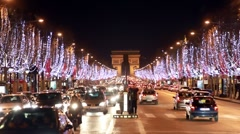 Night traffic on the road near the Arc de Triomphe Stock Footage