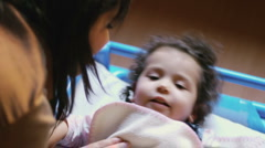 Baby girl resting in bed at school Stock Footage