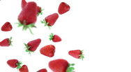 Falling strawberries in the studio. Luma included. Stock Footage