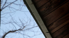 Water dripping off roof Northeast Stock Footage