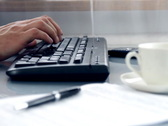 Hands typing on computer keyboard Stock Footage