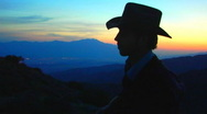 Stock Video Footage of Cowboy Plays Guitar On Mountain At Sunset 06